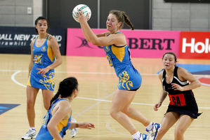 Mt Albert Grammar captain Jamie-Lee Price (centre) her fellow defenders and mid-court ensured that the Tu Toa shooters were made to work hard for every goal. Photo / Mark Mitchell