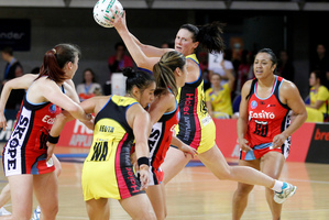 Pulse goal attack Donna Wilkins secures the ball during their ANZ Championship netball match against the Tactix. Photo / Mark Mitchell