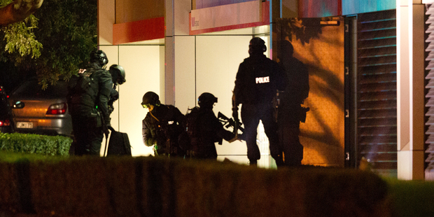 Armed police at the bottom of the Westpac building. Photo / Richard Robinson