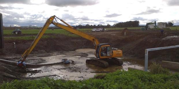 Dredging of effluent ponds has revealed no clues in the hunt for the murderer of farmer Scott Guy.