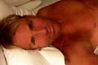 Shane Warne pictured in bed in this image posted to twitter.