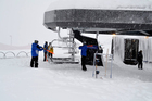 Lift operators work hard to de-ice chairlifts at the Coronet Peak Skifield today. Photo / Facebook