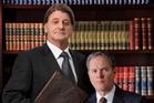 Robert Grubb as Sir Humphrey Appleby and Mark Owen-Taylor as PM Jim Hacke.