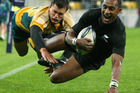 Joe Rokocoko scores against Australia in a 33-6 win in 2009 which marked the start of the current All Black era of domination. Photo / Getty Images