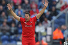 England's Tim Bresnan celebrates trapping Ross Taylor lbw during the ICC Champions Trophy match in Cardiff. Photo / AP