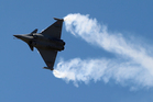 A French Air Force Rafale jet fighter manufactured by France's Dassault Aviation performs its demonstration flight during the first day of the 50th Paris Air Show at Le Bourget airport. Photo / AP