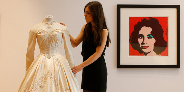 Elizabeth Taylor's first wedding dress, designed by the legendary costume designer Helen Rose is up for auction. Photo / AP