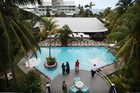 Guests around the pool, pre-Cyclone Evan, at Aggie Grey's in Apia. Photo / Greg Bowker