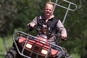 Todd Sheppard with his crash warning device-equipped ATV on the farm at Ngahape.
