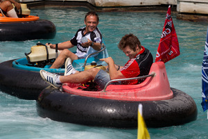 Referee Chris Pollock (left), having fun on the Rainbows End bumper boats with All Black captain Richie McCaw, says his job is easier if he knows the names of both teams' players. Photo / Brett Phibbs