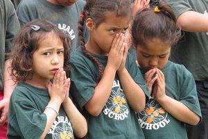 School children join a karakia. Photo / APN