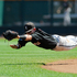 Louisville shortstop Sutton Whiting leaps but cannot reach a two-RBI single hit by Oregon State's Max Gordon in the fourth inning of an NCAA College World Series baseball game in Omaha, Nebraska. Photo / AP