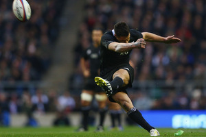 Dan Carter needs 15 points to become the first player to score 1,400 test points. Photo / Getty Images