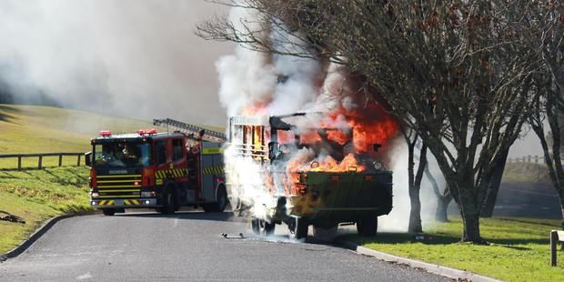 Photographer Matt Sewell captured this image of the Rotorua Duck Tour bus on fire. Photo / Matt Sewell