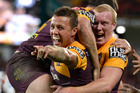 Scott Prince celebrates after scoring a try for the Broncos in Monday night's clash with the Tigers. Photo / Getty Images