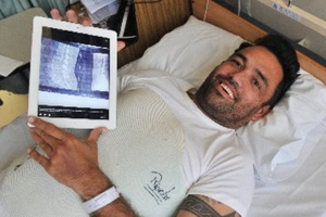 Rueben Skipper recuperates in Dunedin Hospital after shattering a vertebra while bodyboarding at Aramoana. Photo / Linda Robertson