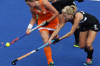 Emily Naylor of New Zealand and Lidewij Welten of Netherlands do battle during the Olympics. Photo / Brett Phibbs