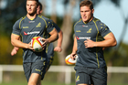 Rob Horne and Michael Hooper train ahead of the firstg Lions test. Photo / Getty Images