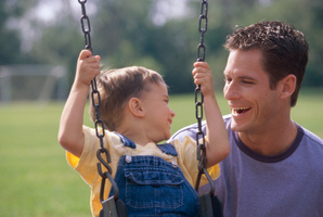 A young boy hears is father for the first time thanks to a microchip on his brain stem. Photo / Thinkstock