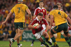Tom Youngs of the Lions takes on Michael Hooper (L) and Kane Douglas during the First Test match between the Australian Wallabies and the British/Irish Lions. Photo / Getty Images