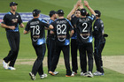 Nathan McCullum celebrates with team mates during the 1st T20 match between England and New Zealand. Photo / Getty Images