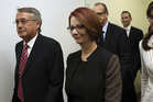 Julia Gillard smiled one last time as she walked into the maelstrom of the leadership ballot. Photo / AP
