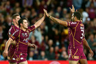 Cooper Cronk of the Maroons and Greg Inglis of the Maroons celebrate during game two of the ARL State of Origin series. Photo / Getty Images