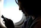 Is it really unsafe to use an mp3 player while flying? Photo / Thinkstock
