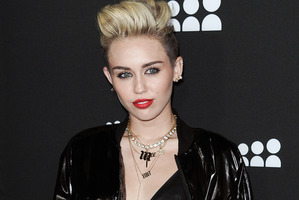 Miley Cyrus has issued her dad with an ultimatum. Photo / AP