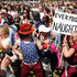 Festival goers participate in a flash mob where the participants dance like Rolling Stones singer Mick Jagger. Photo / AP