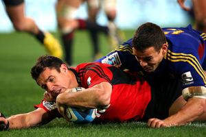 Dan Carter of the Crusaders scores a try in the tackle of Tamati Ellison of the Highlanders during the round 18 Super Rugby match between the Highlanders and the Crusaders. Photo / Getty Images.