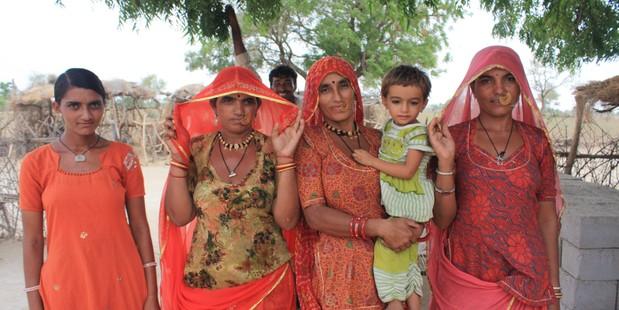 Desert women take pride in their colourful dress. Photo / Paul Rush