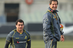 Wallabies coach Robbie Deans looks on as George Smith of the Wallabies stretches during an Australian Wallabies training session. Photo / Getty Images.