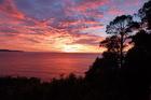 Sunrise over the ocean from the balcony of Casa Bella, Palm Beach, Sydney. Photo / Justine Tyerman