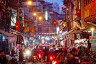 In Asia's party towns, such as Hanoi, female visitors can reduce unwanted attention by dressing modestly. Photo / Bloomberg