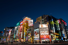 Tokyo puts on a nightly show for visitors with illuminated buildings such as these in the district of Akihabara. Photo / Bloomberg