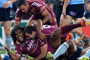 Sam Thaiday of the Maroons celebrates after scoring a try at Suncorp Stadium.Picture / Getty Images