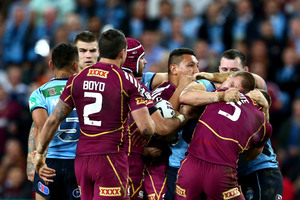 Trent Merrin of the Blues and Brent Tate of the Maroons fight during game two of the ARL State of Origin series. Photo / Getty Images