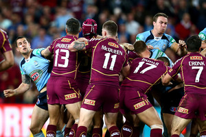 Blues and Maroons players fight during State of Origin game two. Photo / Getty Images