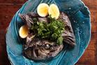 Slow roasted fish heads. Photo / Doug Sherring