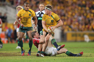 Brian O'Driscoll, here tackling Wallaby Michael Hooper, was reportedly too scared to contest the ball after his first penalty. Photo / Getty Images