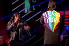 Dizzee Rascal (left) and Robbie Williams get the megaupload name in front of the crowd.