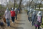 A flock of protesters made mischief for a Google Streetview car by swooping in wearing latex pigeon heads when the roving vehicle was spotted near Mitaka Station in Musashino, Tokyo, by bloggers at Daily Portal Z.