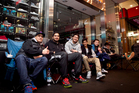 Sneaker fans including Joshua McKee (left), Akhail Baluja and Adrianne Escondo wait for the shoes. Photo / Natalie Slade