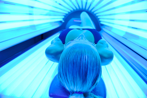 The Cancer Society says the law will help control people's exposure to cancer-causing UV rays. Photo / Getty Images