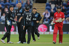 Team-mates salute Daniel Vettori's success in dismissing England's Eoin Morgan in a Champions Trophy match. Photo / AP