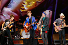 From left to right, Ronnie Wood, Mick Jagger, and Keith Richards of the Rolling Stones, and guest star Brad Paisley perform at the Wells Fargo Center in Philadelphia. Photo / AP