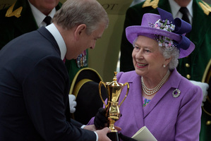 A wonderful moment for the Queen as her son Prince Andrew presents her with the Gold Cup after Estimate's win last Friday at Royal Ascot. Photo / AP