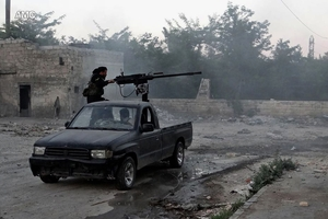 Bickering among rebel groups over weapons supplies has done nothing to further their cause. Photo / AP