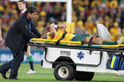 Christian Leali'ifano was the first of the Wallabies to be stretchered off at Suncorp Stadium on Saturday. Photo / AP